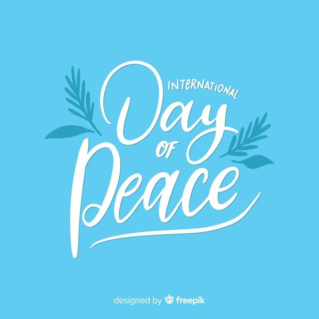 Concept de fête de la paix avec lettrage Vecteur gratuit