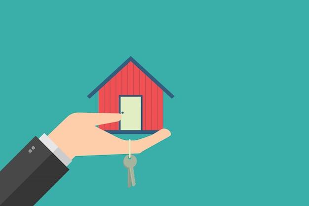 Concept De Finance D'entreprise, Main Tenant La Maison Dans La Paume Et La Clé. Design Plat Vecteur Premium