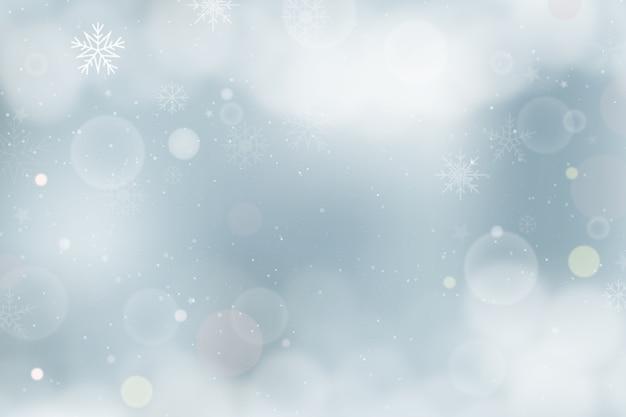Concept d'hiver avec un arrière-plan flou Vecteur gratuit