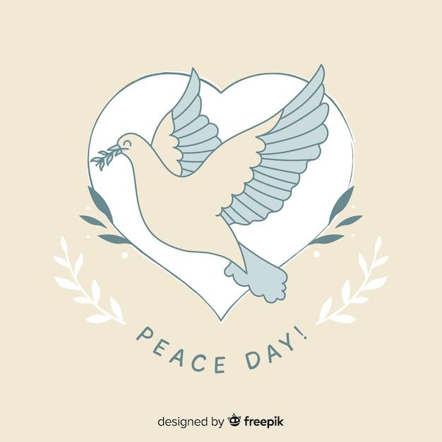 Concept De Jour De Paix Avec Colombe Dessiné à La Main Vecteur gratuit