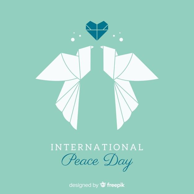Concept de la journée de la paix avec la colombe origami Vecteur gratuit