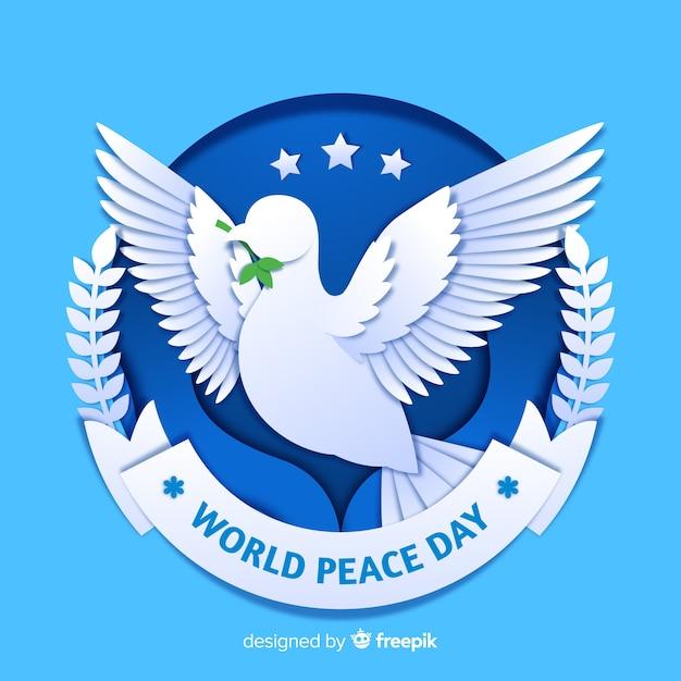 Concept de la journée de la paix avec une colombe Vecteur gratuit