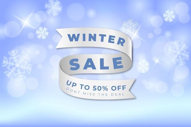 Concept de vente d'hiver floue avec ruban Vecteur gratuit