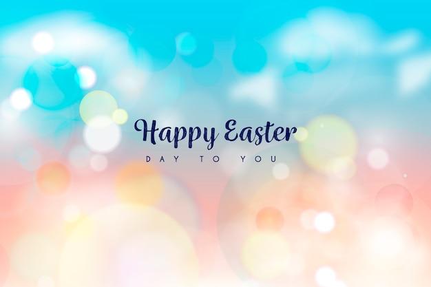 Conception De Bokeh Joyeux Pâques Vecteur gratuit