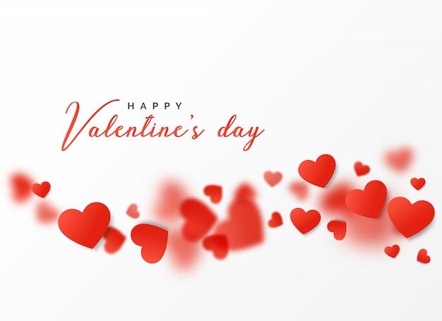 Conception de carte heureuse saint-valentin avec des coeurs flottants Vecteur gratuit