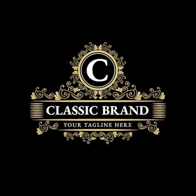 Conception De Logo De Luxe De Style Vintage Antique Monogramme Héraldique Dessiné Main Floral Calligraphique Or Floral Vecteur Premium