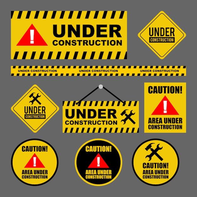 En construction attention design set Vecteur Premium