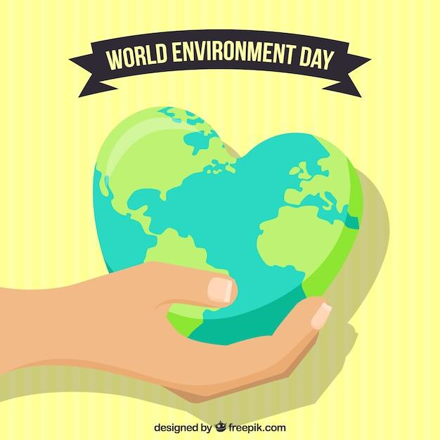 Contexte de la journée mondiale de l'environnement avec la main tenant un globe terrestre avec une forme de coeur Vecteur gratuit