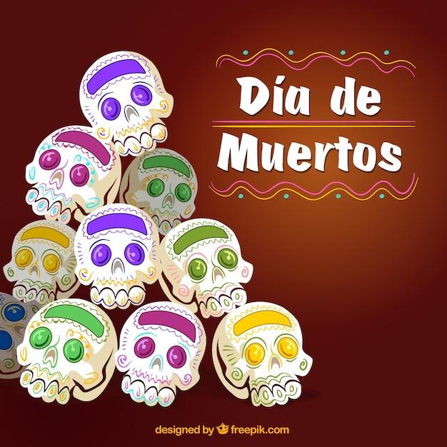 Contexte De La Journée Des Morts Avec Des Crânes Mexicains Dessinés à La Main Vecteur gratuit
