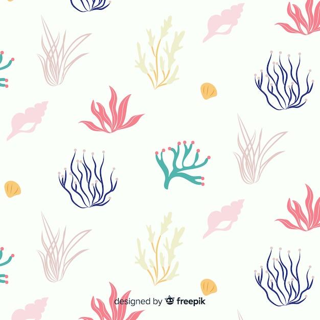 Corail dessiné à la main avec fond d'animaux marins Vecteur gratuit