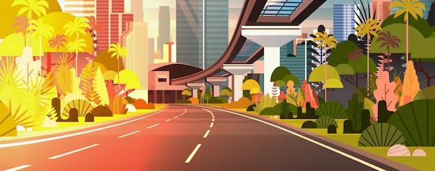 Coucher de soleil moderne ville vue illustration horizontale route avec des gratte-ciel et chemin de fer Vecteur Premium