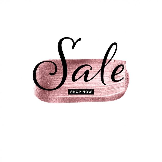 Coup de pinceau dessiné à la main en or rose avec texte de vente Vecteur Premium