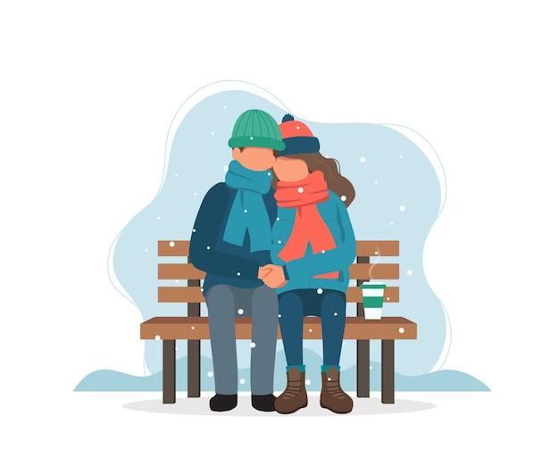 Couple assis sur un banc en hiver avec un café. Vecteur Premium