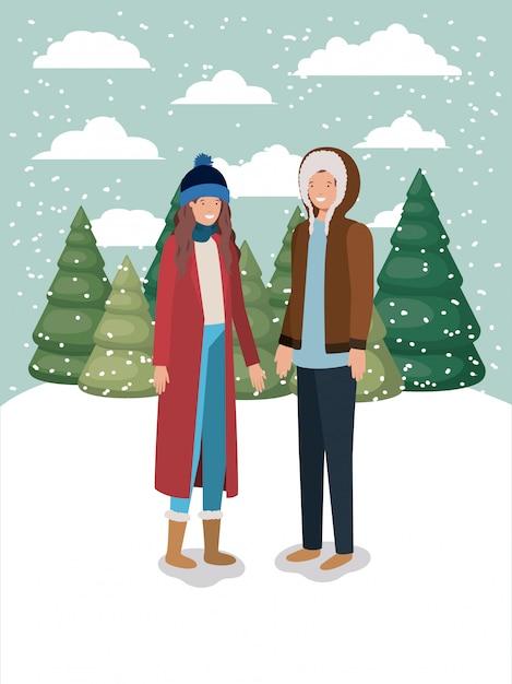 Couple dans le paysage de neige avec des vêtements d'hiver Vecteur Premium