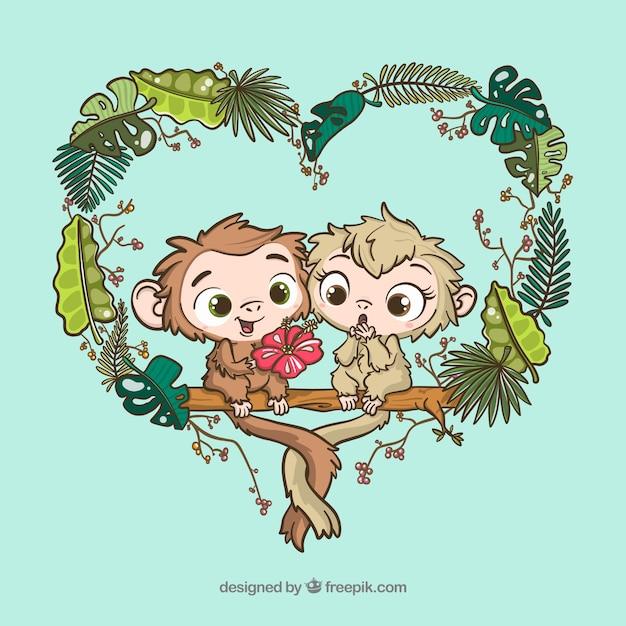 Couple dessiné à la main de beaux singes Vecteur gratuit