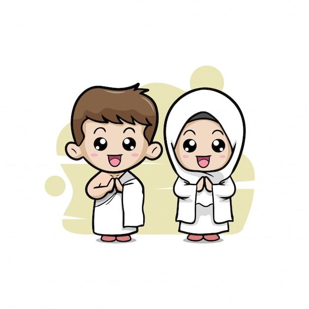 Un couple d'enfants musulmans vêtus du hajj Vecteur Premium
