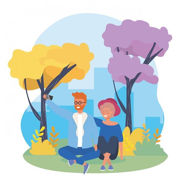Couple garçon et fille avec des arbres et des arbustes Vecteur gratuit