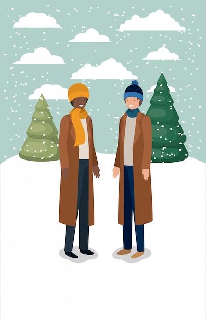 Couple d'hommes dans le paysage de neige avec des vêtements d'hiver Vecteur Premium