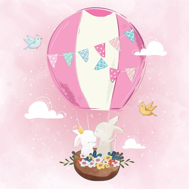 Couple de lapin dans la montgolfière Vecteur Premium