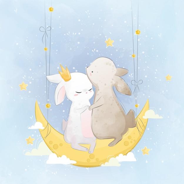 Couple de lapin sur la lune Vecteur Premium