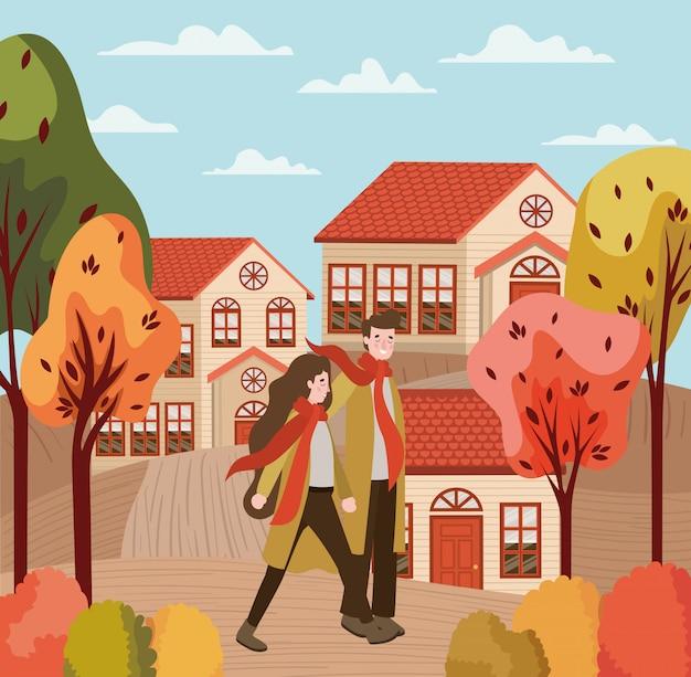 Couple marchant avec des costumes d'automne dans la ville Vecteur Premium