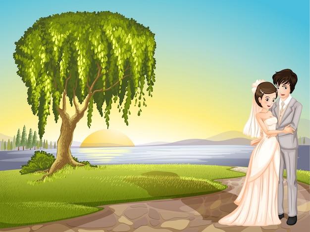 Un couple à travers l'arbre Vecteur gratuit