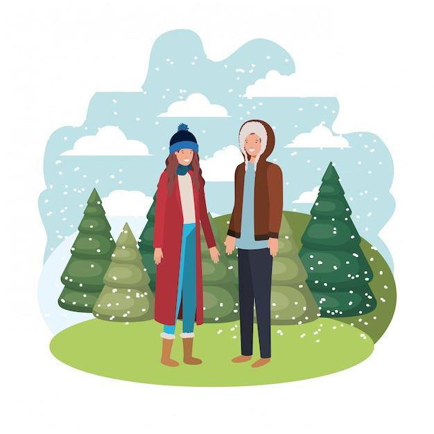 Couple avec vêtements d'hiver et personnage d'avatar de pin d'hiver Vecteur Premium