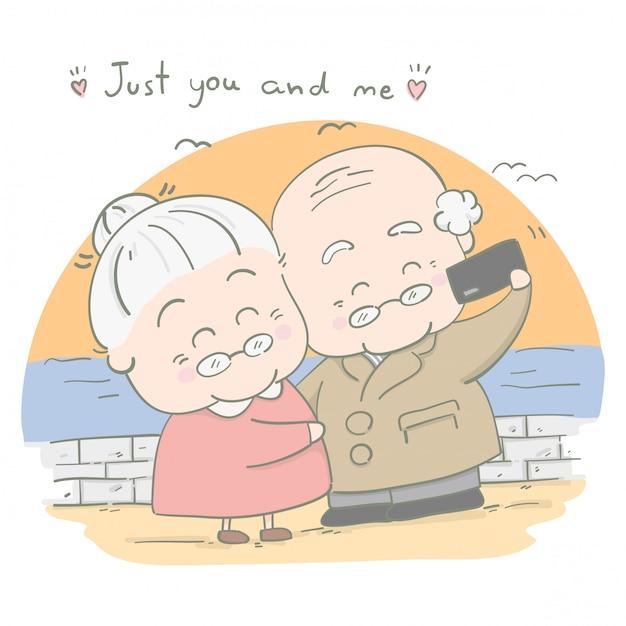 Les couples âgés prennent des photos ensemble en vacances Vecteur Premium