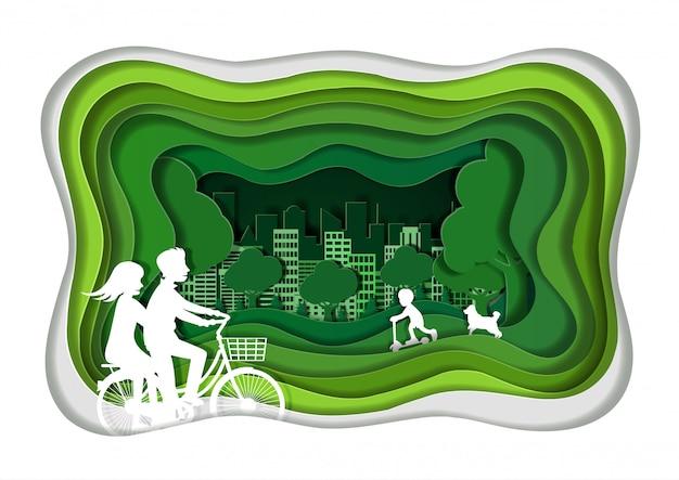 Les couples font du vélo sur une pelouse verte en profitant de vacances relaxantes. concept de ville verte. Vecteur Premium