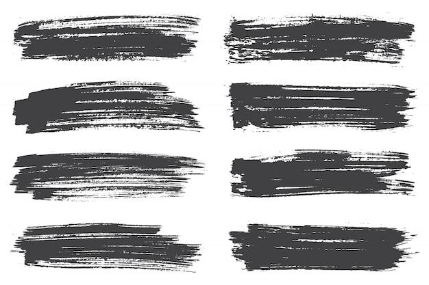 Coups de pinceau noirs Vecteur Premium