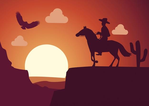 Cow-boy dans le désert au coucher du soleil Vecteur Premium