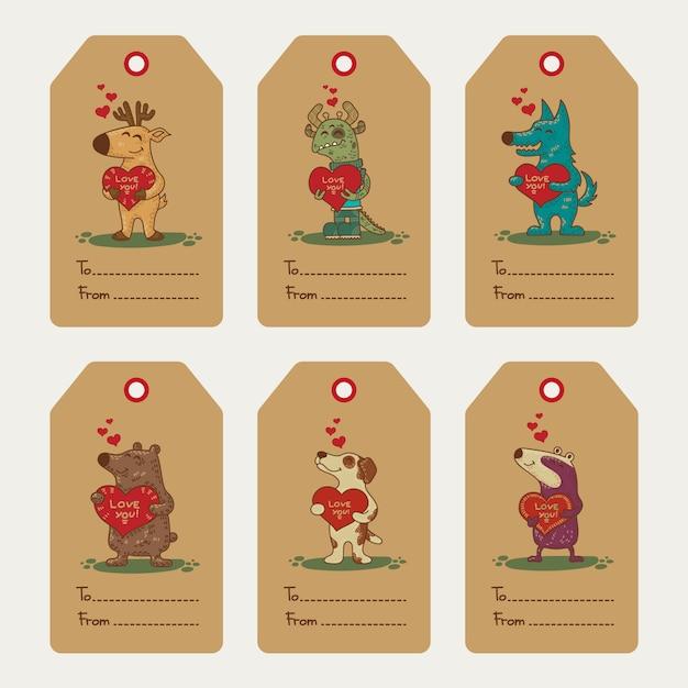 Craft doodle étiquettes tribales avec des animaux. Vecteur Premium
