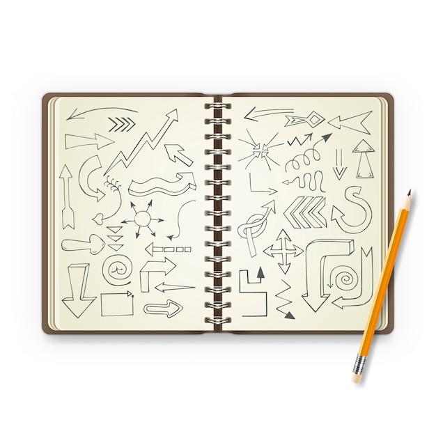 Crayon et cahier ouvert avec des flèches peintes Vecteur Premium