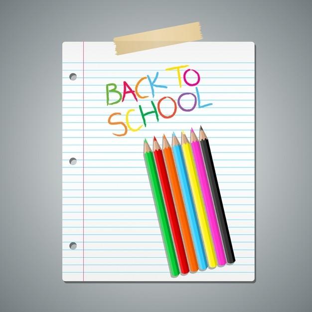 Crayons de couleur sur papier ligné Vecteur gratuit