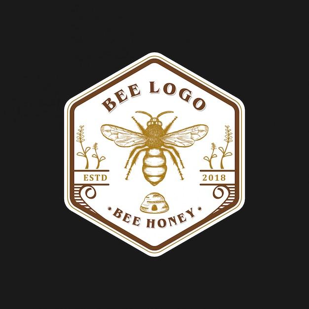 Création de logo abeille vintage Vecteur Premium