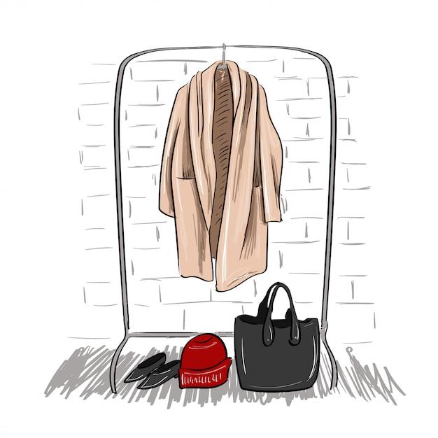 Croquis du manteau suspendu à un cintre Vecteur Premium