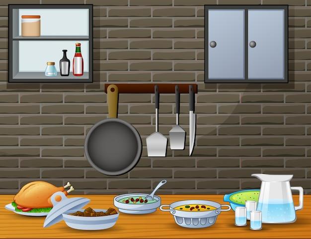 Cuisine sur la table à manger dans la cuisine Vecteur Premium