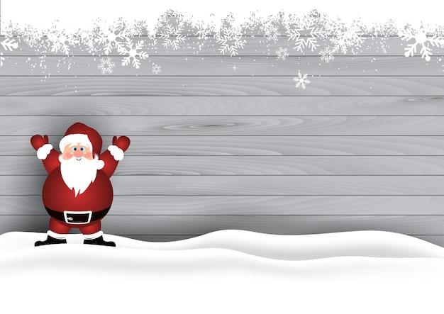 Cute Santa dans la neige sur un fond de texture en bois Vecteur gratuit