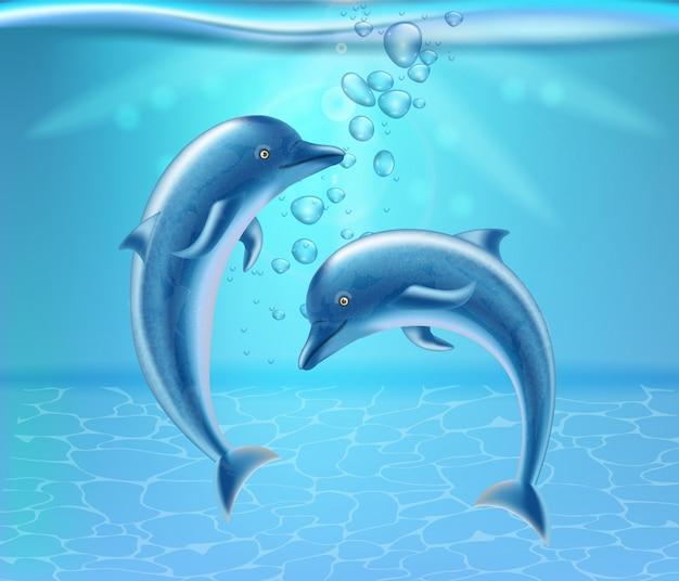 Dauphins sous l'eau Vecteur Premium