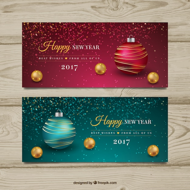 Décoratifs nouvelles bannières année avec des boules de noël Vecteur gratuit