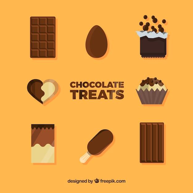 Délicieuses pièces de chocolat et collection de bonbons Vecteur gratuit