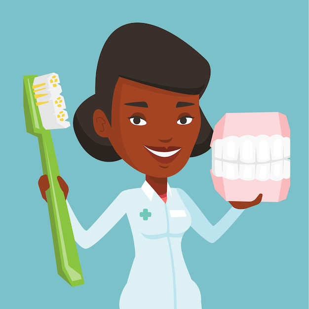 Dentiste Avec Modèle De Mâchoire Dentaire Et Brosse à Dents. Vecteur Premium