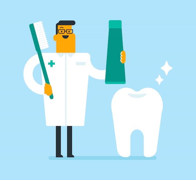 Dentiste tenant un dentifrice et une brosse à dents. Vecteur Premium