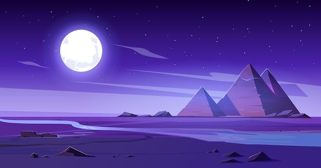 Désert égyptien Avec Rivière Et Pyramides De Nuit. Vecteur gratuit