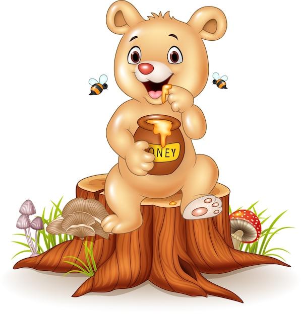 Dessin Animé Drôle Bébé Ours Tenant Le Pot De Miel Sur Une