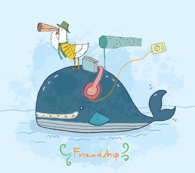 Dessin animé mignon baleine et mouette voyageant ensemble comme amitié. Vecteur Premium
