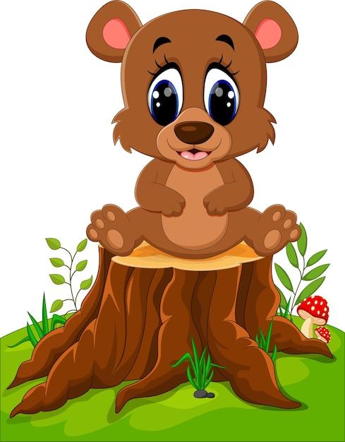 Dessin animé ours assis sur une souche d'arbre Vecteur Premium