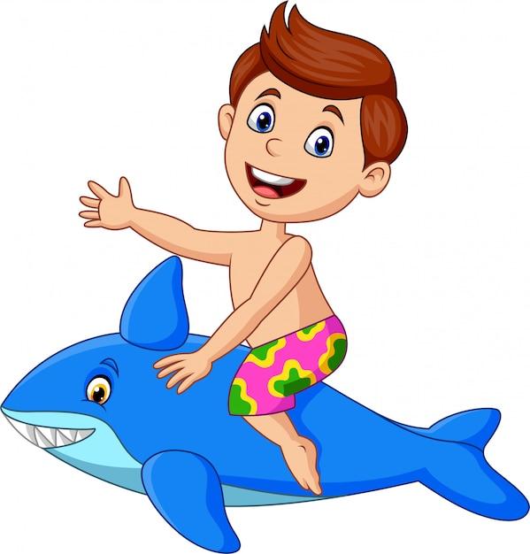 Dessin Animé Petit Garçon Chevauchant Un Requin Gonflable
