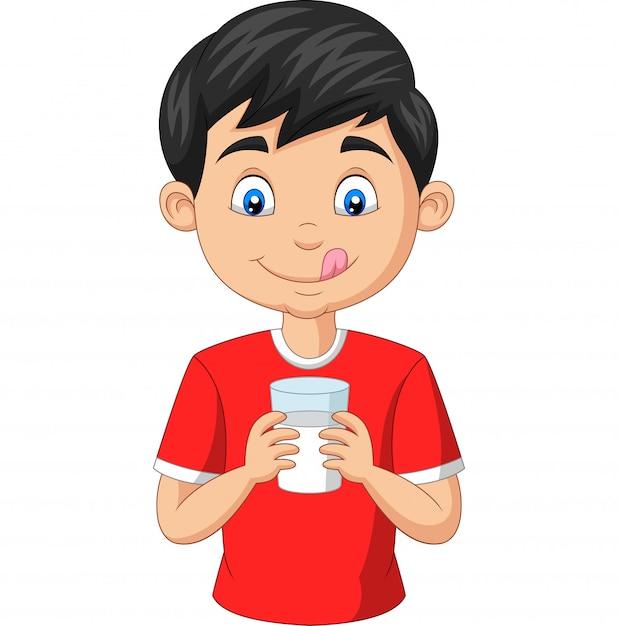 Dessin animé petit garçon tenant un verre de lait Vecteur Premium