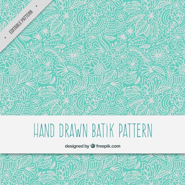 dessiné motif batik ornement floral à la main Vecteur gratuit